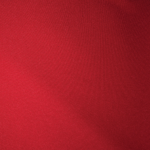Close up of an apple red colored polyester tablecloth.