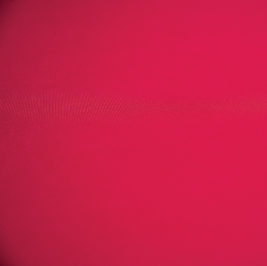 Close up of an apple red colored spandex tablecloth.