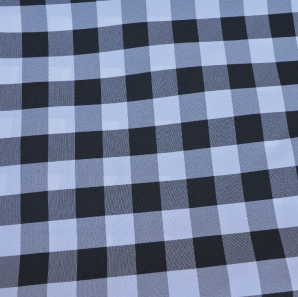Close up of a black gingham check polyester tablecloth.