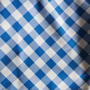 Close up of a blue gingham check polyester tablecloth.
