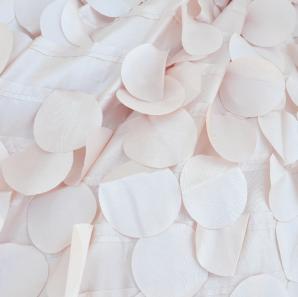 Close up of a blush petal tablecloth.