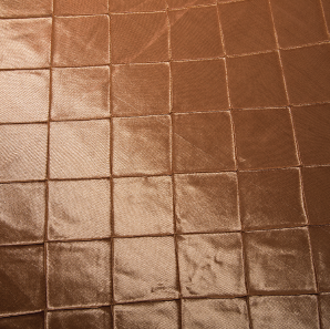 Close up of a champagne colored tuck overlay