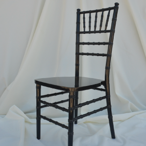 Black Chiavari chair in front of  a white backdrop.