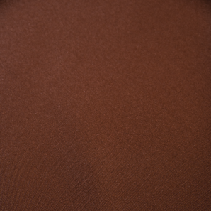 Close up of a chocolate brown colored polyester tablecloth.