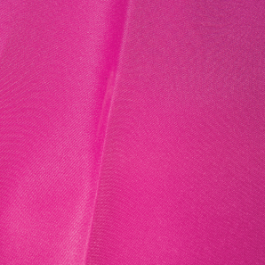 Close up of a hot pink polyester tablecloth.