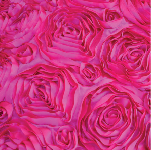 Close up of a hot pink rosette tablecloth.