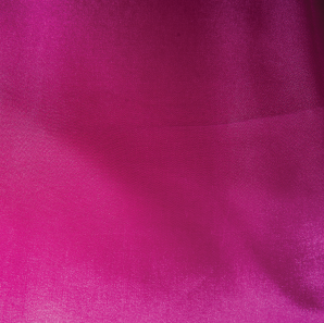 Close up of a hot pink colored tablecloth.