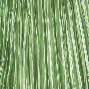 Close up of a mint green colored crinkled accordion tablecloth.
