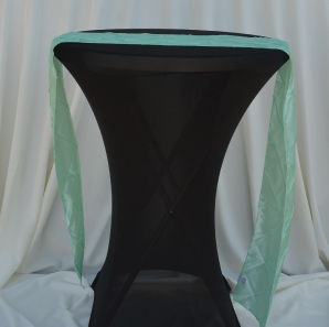 Close up of a mint sequined table runner.