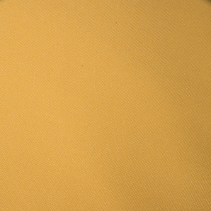 Close up of a mustard colored polyester tablecloth.
