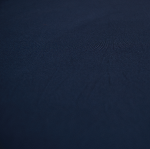 Close up of a navy blue spandex tablecloth.