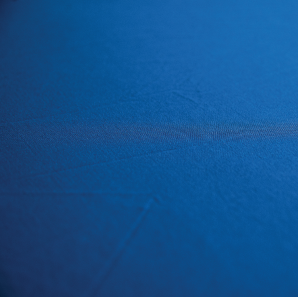 Close up of an ocean blue spandex tablecloth.