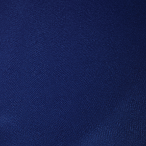 Close up of a royal blue polyester tablecloth.