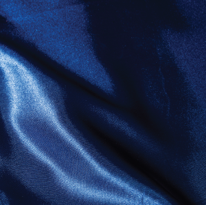 Close up of a royal blue silk tablecloth.