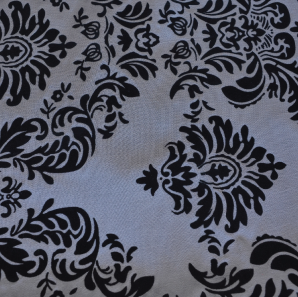 Close up of a silver black patterned overlay.