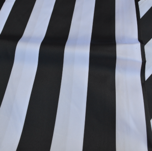 Close up of a white and black striped table runner.