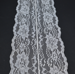 Close up of a white lace table runner.