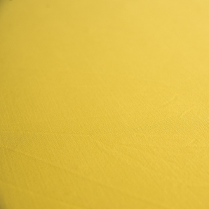 Close up of a yellow spandex tablecloth.