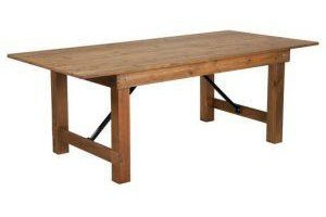 Rustic pine folding farm table in front of a white background.